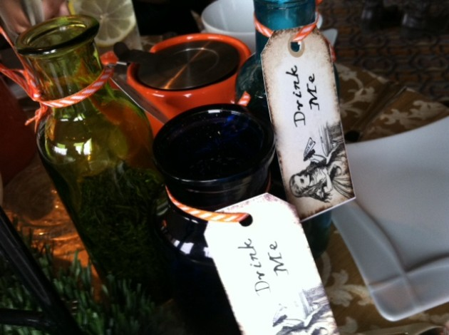 Jars holding tea leaves have mischievous labels at the Mad Hatter's tea party.