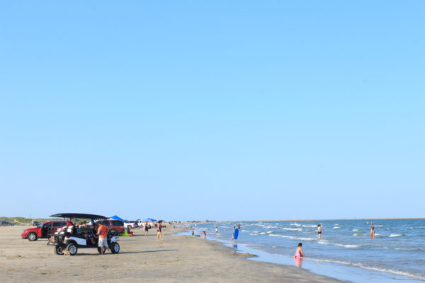 Tourists line a Port Aransas beach.