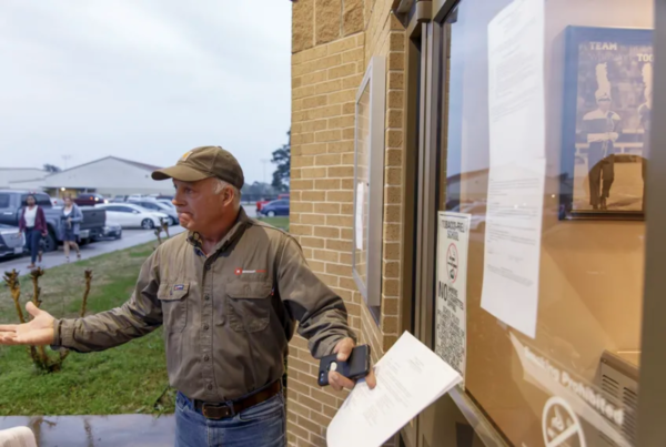 Shepherd ISD board trustee Michael Courvelle outside of the district administration building on Monday.