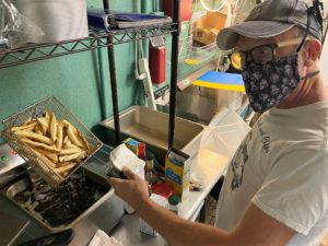 a man frying french fries