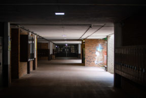 a dark high school hallway